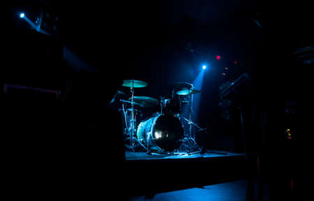 cymbal: Dark and grainy image of a stage ready for a music band live performance