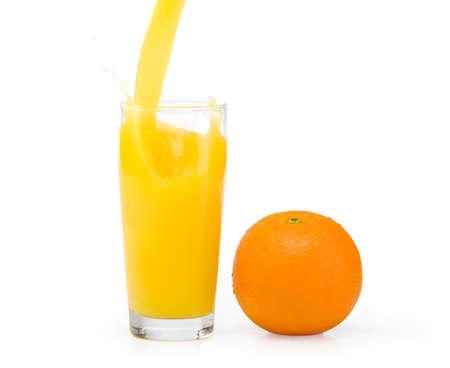 A glass of orange juice on a white background and orange photo