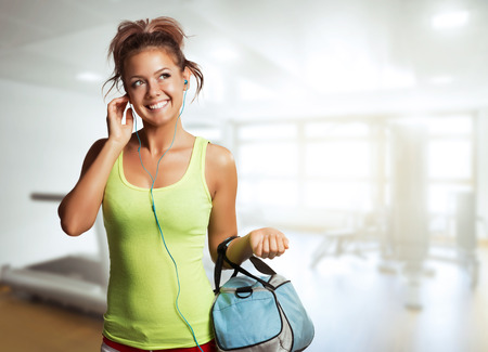 gym clothes: Young Woman in sport wear walking in gym Stock Photo