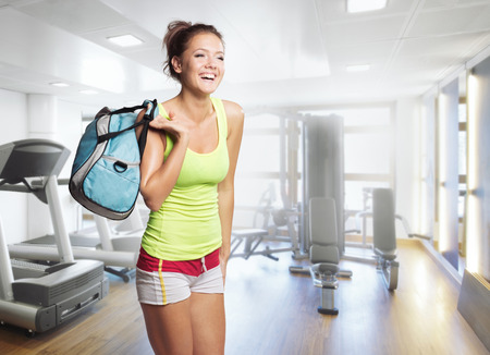 Young Woman in sport wear walking in gym Banco de Imagens