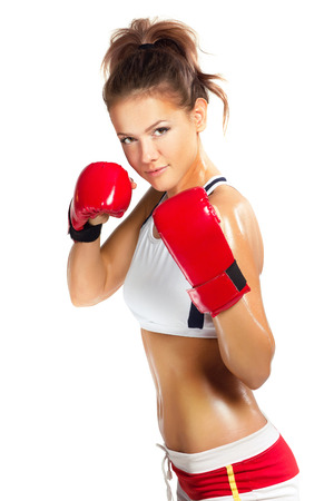 boxing sport: boxer woman during boxing exercise in defence position with red gloves