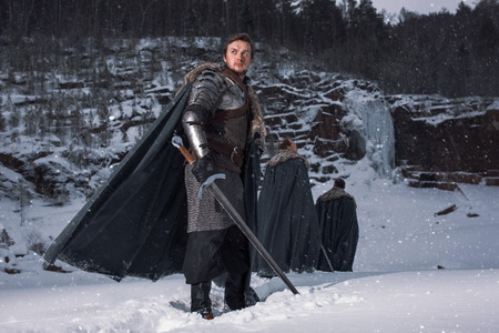 Medieval knight with sword in armor   Standard-Bild