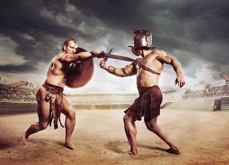 armour: Gladiators fighting on the arena of the Colosseum Stock Photo
