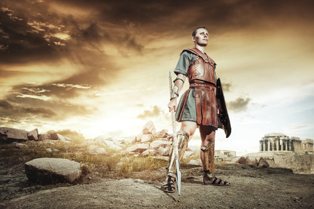 Ancient Greek warrior Hector posing and fighting in the combat Stock Photo