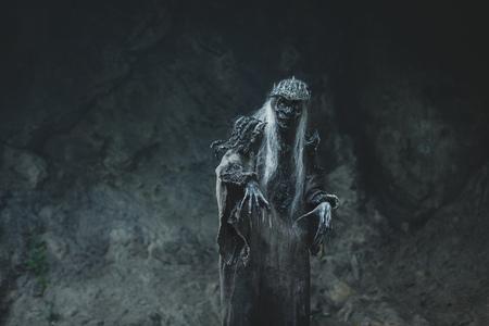 otherworldly: Male demon. Art studio shot. Goth necromancer with horror bodyart Stock Photo