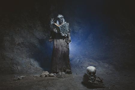 necromancer: Male demon. Art studio shot. Goth necromancer with horror bodyart Stock Photo