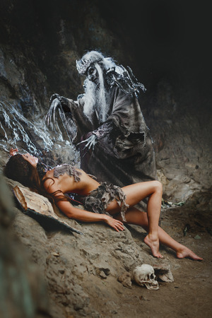 necromancer: Necromancer makes a demonic ritual over her victim. Bodyart Stock Photo