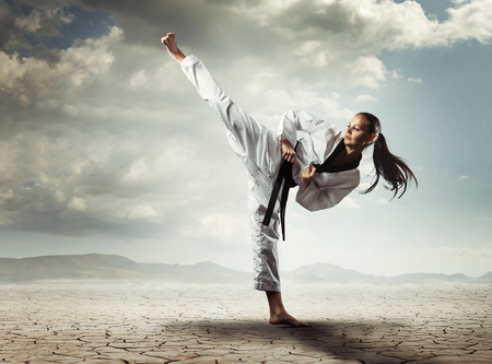 Karate girl kick Stock Photo