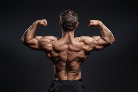 Handsome power bodybuilder showing his back Banco de Imagens