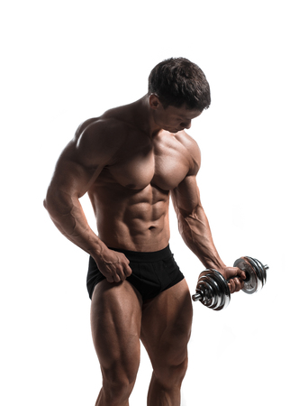 Handsome power athletic man pumping up muscles isolated over white. Strong bodybuilder with perfect shape body and six pack, abs, shoulders, biceps, triceps and chest. 版權商用圖片
