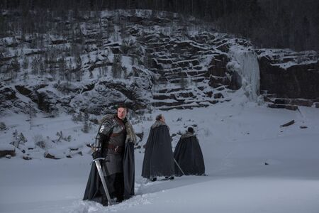 Medieval knights with sword in armor  going in Winter Rock Landscapes