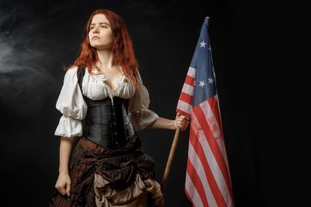 Girl in historic dress from United States Revolutionary War with flag. July 4th, Independence Day USA Concept Photo Composition Stok Fotoğraf