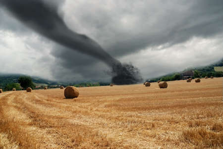 hurricane: twister on countryside with dark sky