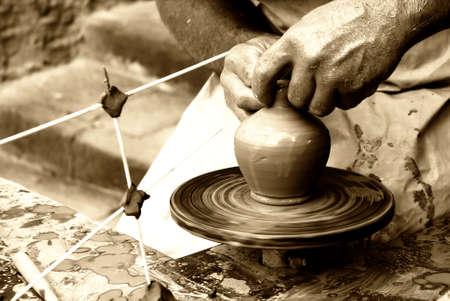man doing an ancient craft