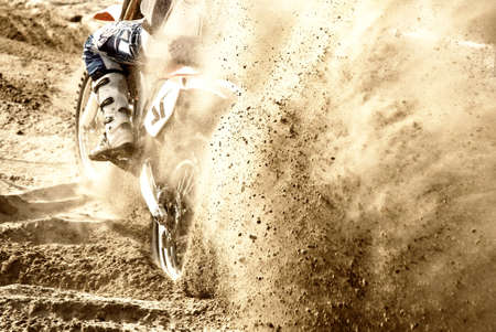 skid: motocross starting on the sand Stock Photo