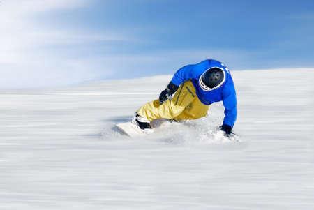 snowboarder: fastest skier under blue sky Stock Photo