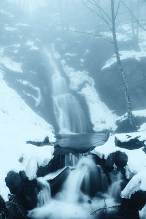 waterfall in the fog and snow photo