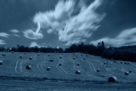 bales of hay in the night with moon Stock Photo - 8965720
