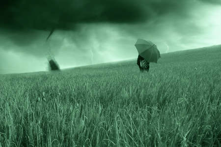 man watching the tornado into a corn field photo