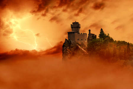 castle shrouded by clouds and mist fire red