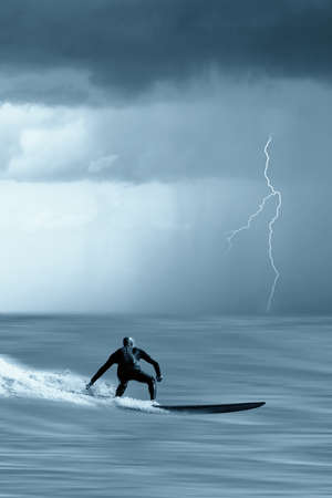 brave surfer looking the incoming storm photo
