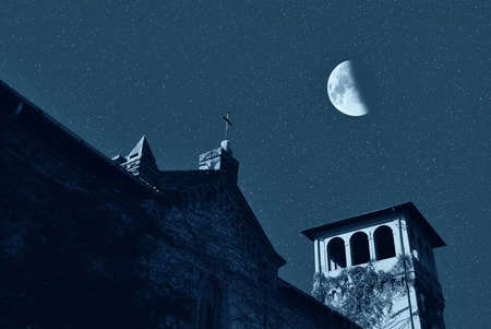 church under the starry sky with moon photo