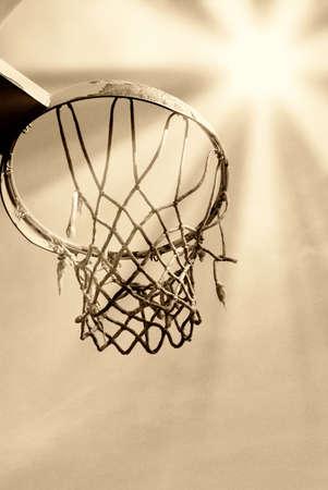 old basket ball under dramatic sky photo
