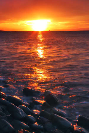 red sunset with soft waves photo