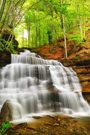 cascade mountains: cool waterfall run on the rocks in autumn