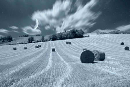 night cloudy sky and field photo