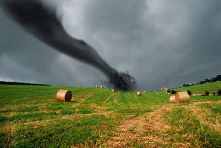 straw bales into the storm with tornado  Stock Photo
