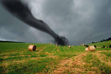 tornado: straw bales into the storm with tornado  Stock Photo