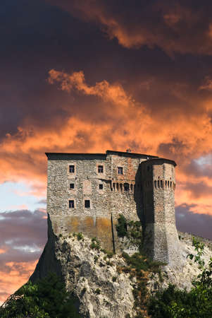 red sunset and clouds over the castle photo