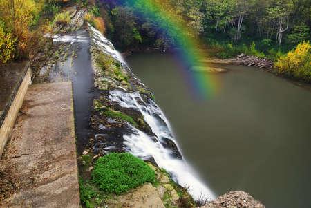 small rainbow near the waterfall photo