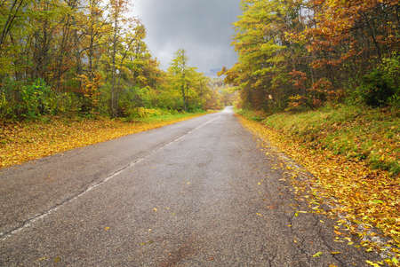 first days of autumn on mountain road photo