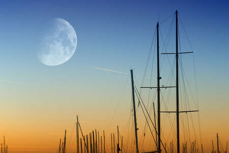 sunset over the port with moon photo