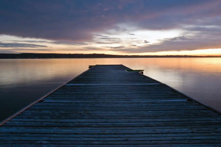 wood pier over calm waters of the sea photo