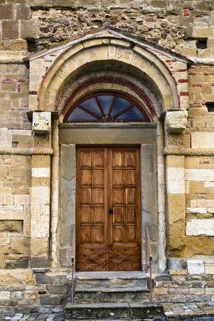 antique door to enter the church photo