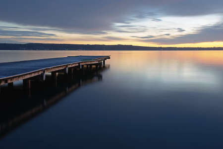 tranquil: calm waters of the sea at sunset Stock Photo