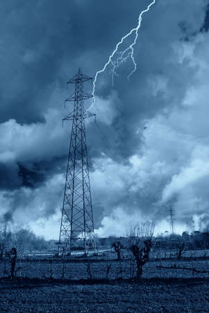 over voltage: lightning over an high voltage pylon Stock Photo