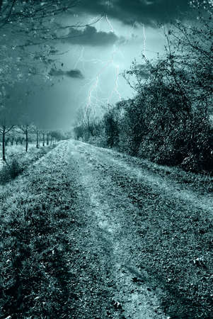 dreamy road to the storm in the night photo