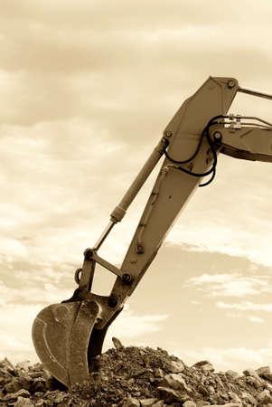digger shovel over big  mound Stock Photo - 9633478