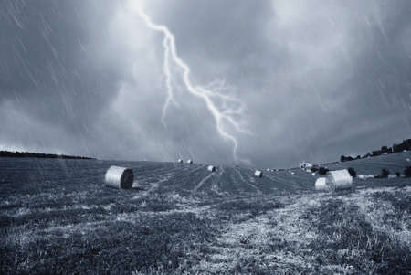 stormy sky with rain on the countryside photo