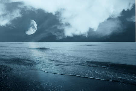 moon over the ocean in the night Stock Photo