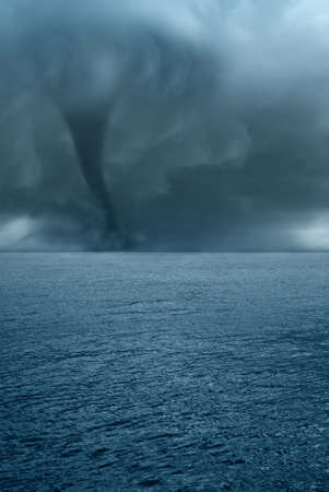 twister: twister with dark clouds on the ocean Stock Photo
