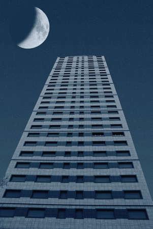 moon over the skyscraper in the night photo