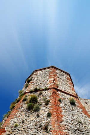 insurmountable: old stones tower under blue sky