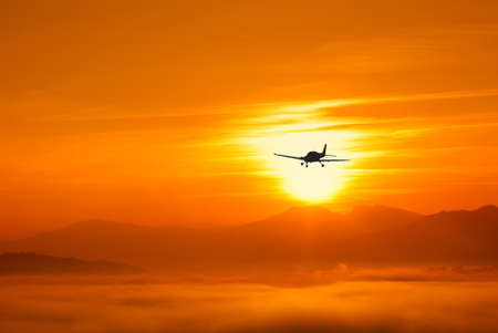 amazing sunset with airplane in the sky photo