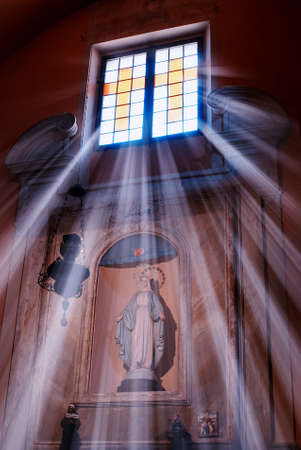 gothic window: light trough the window of the church