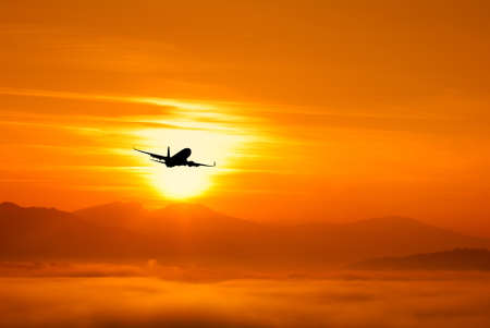 airplane flying to the sun photo